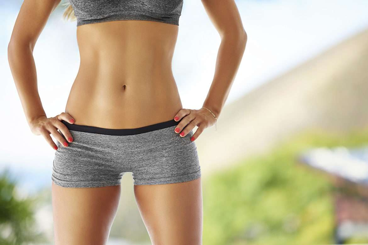 Cropped shot of a woman with flat abs posing outside in sportswearhttp://195.154.178.81/DATA/i_collage/pi/shoots/804545.jpg